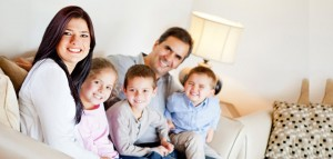 Family enjoying their comfortable home after installing energy efficient insulation in their Wayzata home.